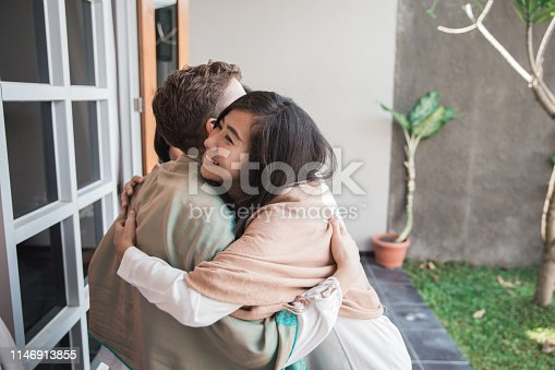 istock family forgiving and apologizing each other. eid mubarak 1146913855