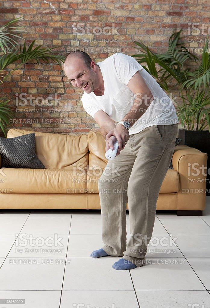 Family Fun: Sony PlayStation 3 Move golfer royalty-free stock photo