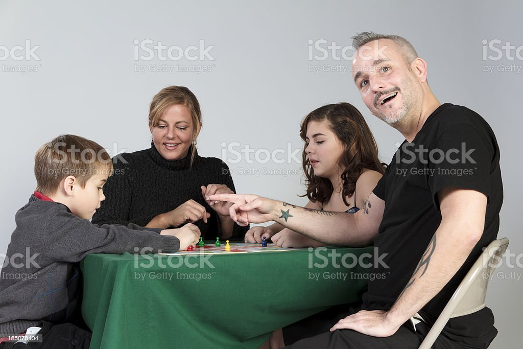 Family Game Night -- Surprise Move stock photo