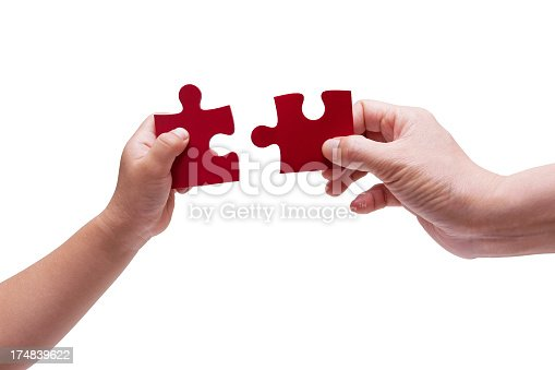 istock Family game with jigsaw puzzle (Clipping path!) isolated 174839622