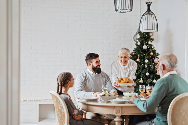 Family gathered over Christmas holidays, celebrating, having lunch stock photo