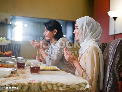 Family gathering and eating together during eid celebration in Malaysia