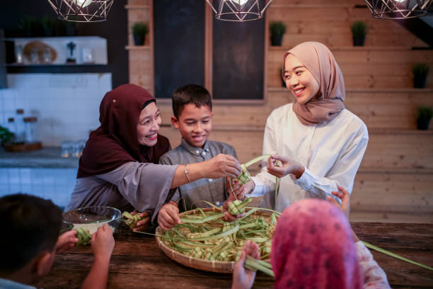 family gathering and preparing food - eid stock pictures, royalty-free photos & images