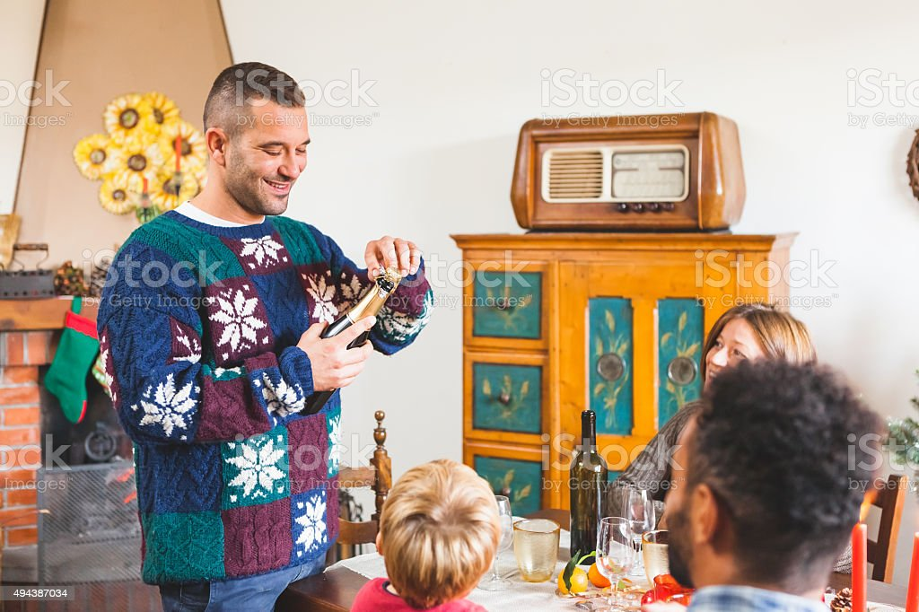 Family Gathers for Christmas Dinner stock photo