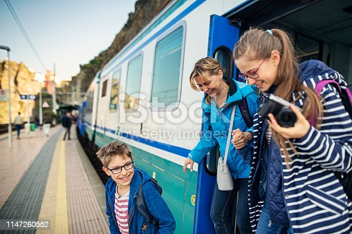 Family getting out of train at the Manarola train station, Cinque Terre. Happy family is anxious to begin sighseeing of beautiful italian town. Nikon D850