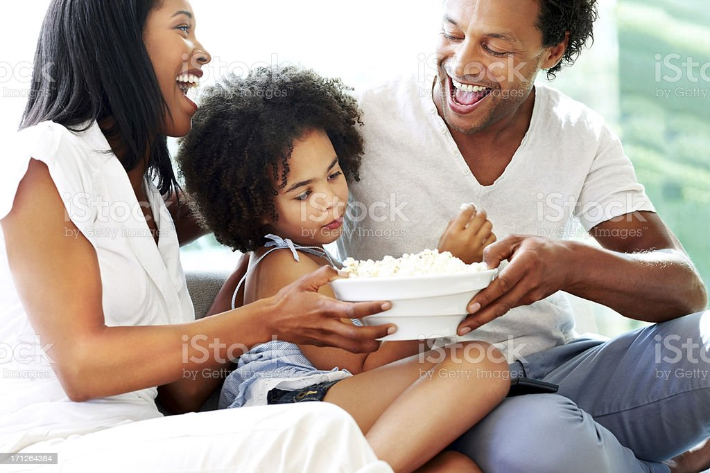 Family getting ready to watch movie royalty-free stock photo