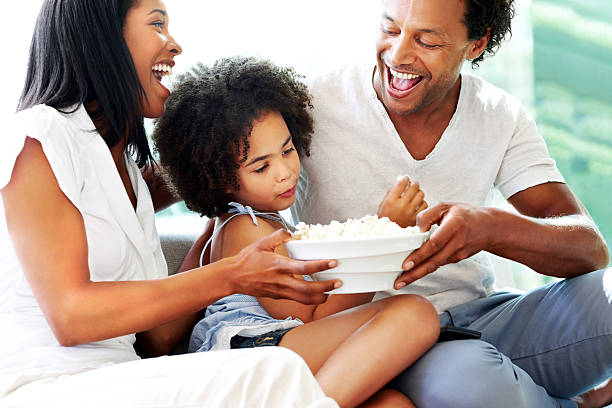 Family getting ready to watch movie stock photo
