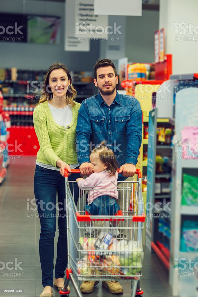 Family Groceries Shopping In Supermarket. stock photo