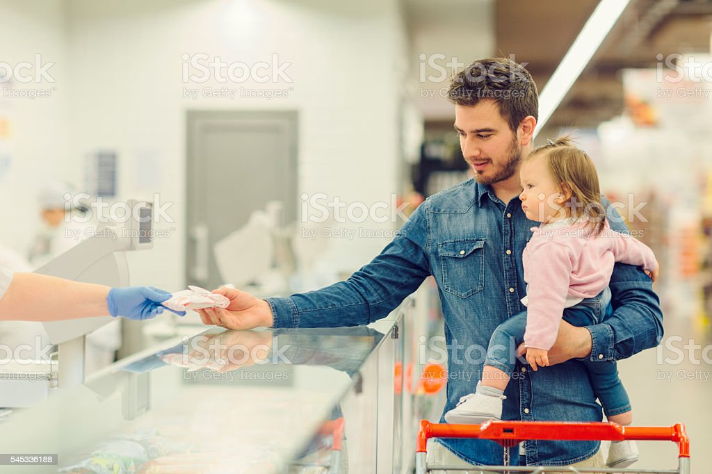 Family Grocery Shopping In Their Local Supermarket. stock photo