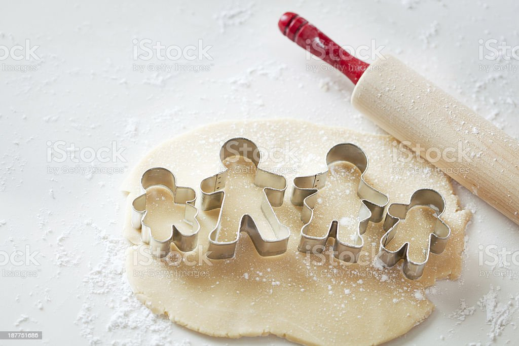 Family Group Cookie Cutter on Dough with Rolling Pin Horizontal.jpg stock photo