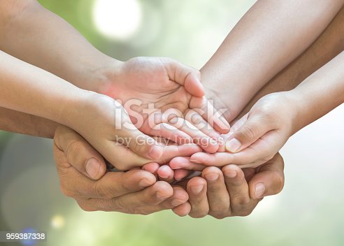 istock Family hands praying together (clipping path) for donation charity concept 959387338