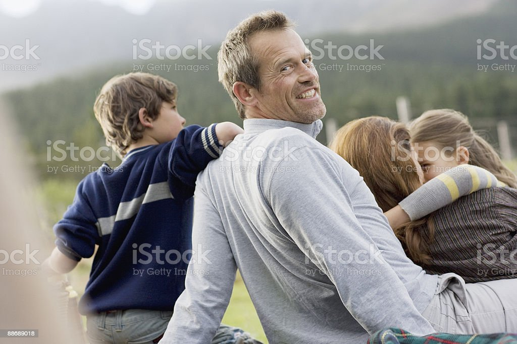 Family hanging out together outdoors stock photo
