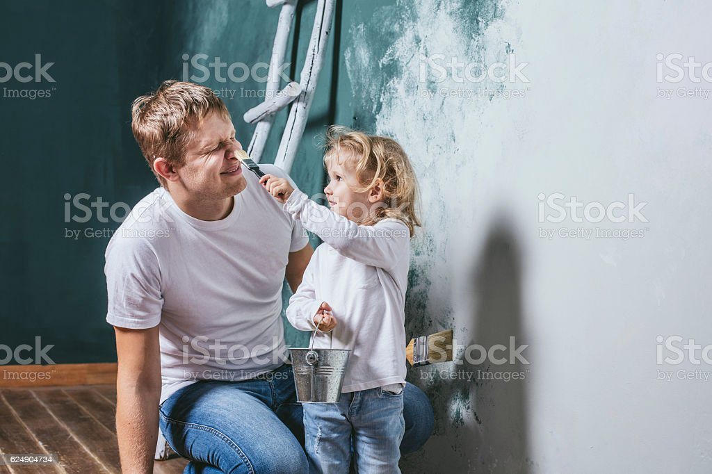 Family, happy daughter with dad doing home repair, paint walls, - foto de acervo