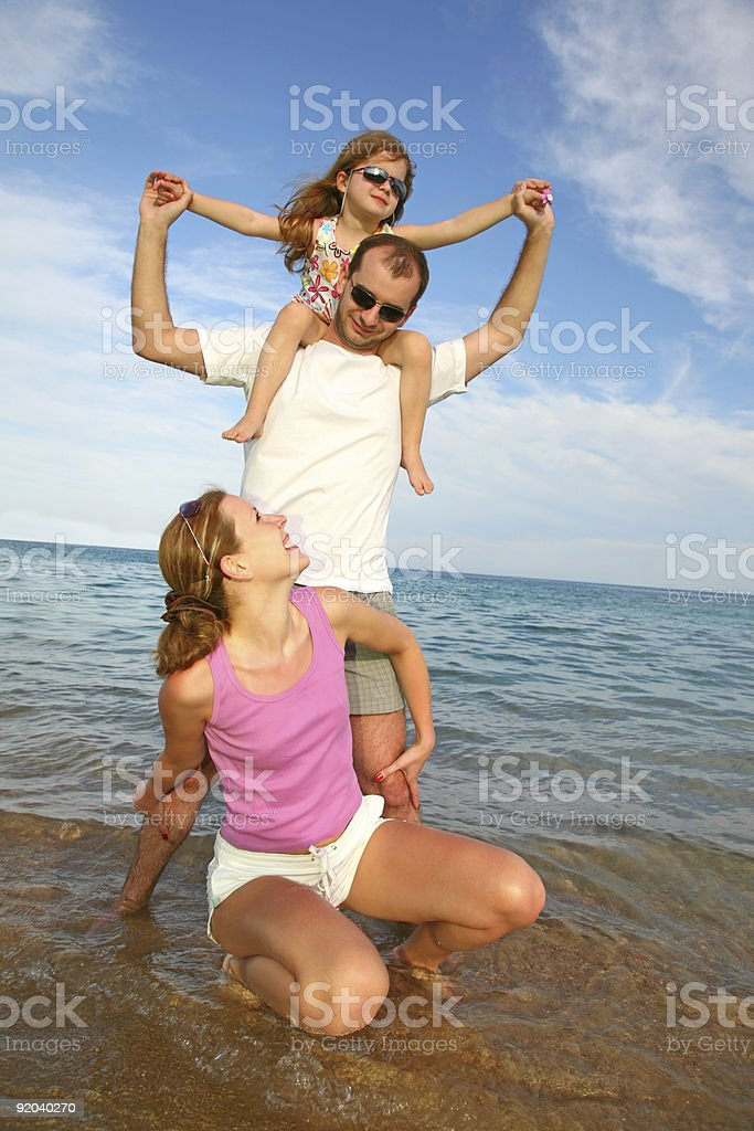 family has a rest on sea stock photo