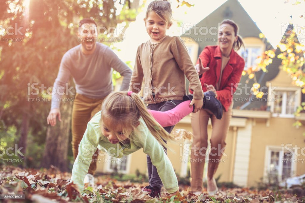 Family have fun.  Sisters carrying  itch other. stock photo