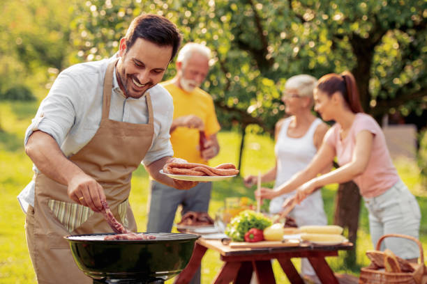 Family having a barbecue party in their garden stock photo