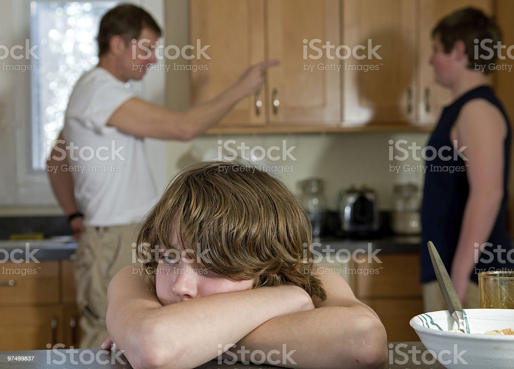 A family having a conflict in the kitchen royalty-free stock photo