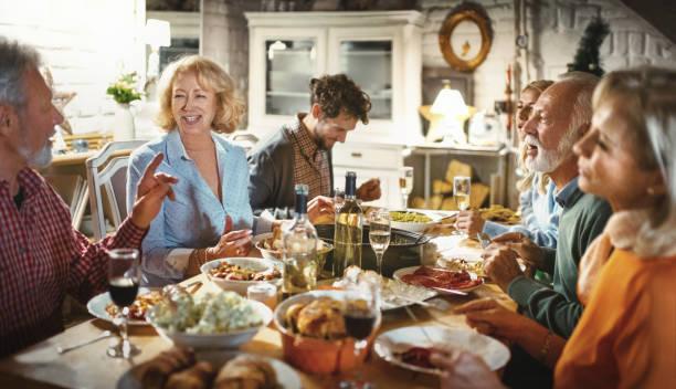 family having a dinner party. - kolacja spotkanie towarzyskie zdjęcia i obrazy z banku zdjęć