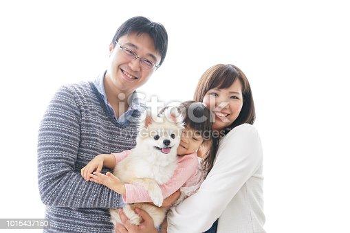 942596618 istock photo Family having a dog 1015437150