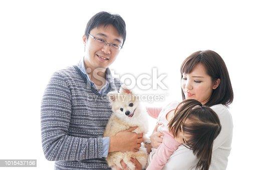 942596618 istock photo Family having a dog 1015437156