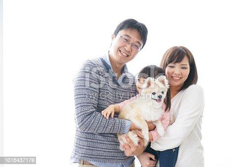 942596618 istock photo Family having a dog 1015437176