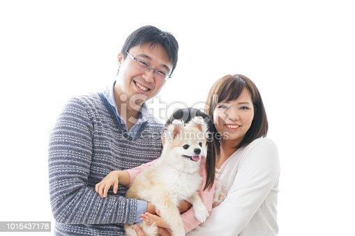 942596618 istock photo Family having a dog 1015437178