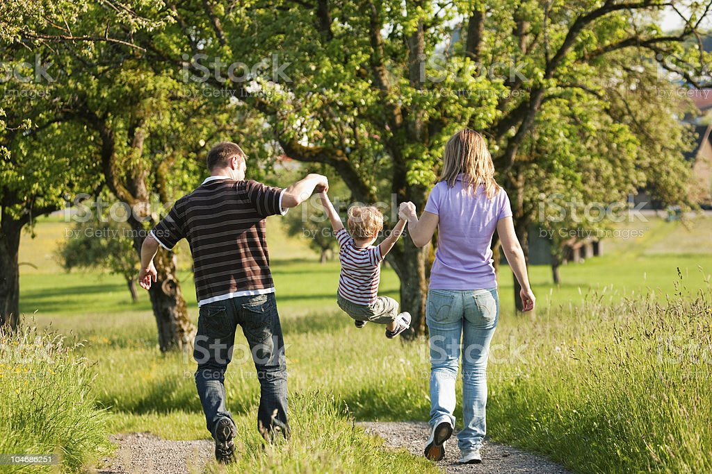 Family having a walk outdoors in summer royalty-free stock photo