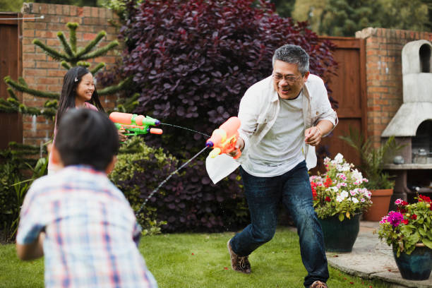 Family Having a Water Fight stock photo