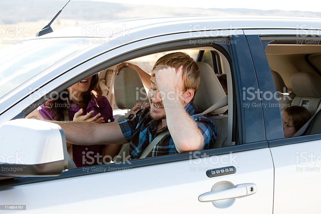 Family having argument in car stock photo