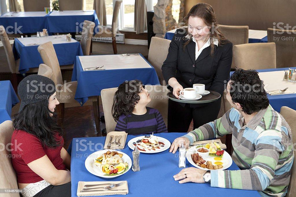 Family having breakfast in a restaurant royalty-free stock photo