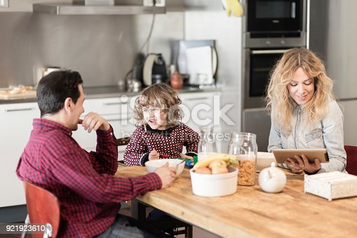 istock Family having breakfast in the kitchen at home 921923610
