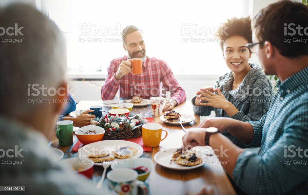 Family having breakfast on Christmas morning. stock photo