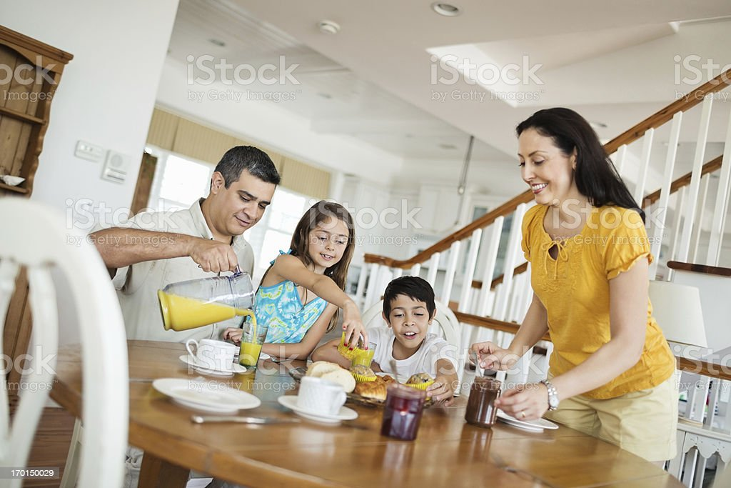 Family Having Breakfast Together At Table royalty-free stock photo