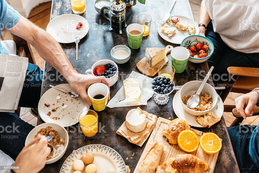 family having breakfast together in holidays stock photo