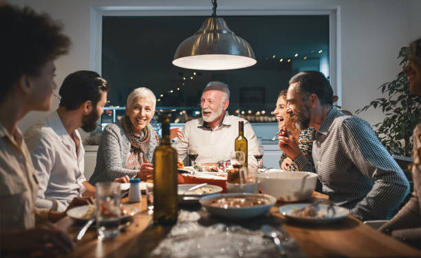 family having dinner on christmas eve. - party social event stock pictures, royalty-free photos & images