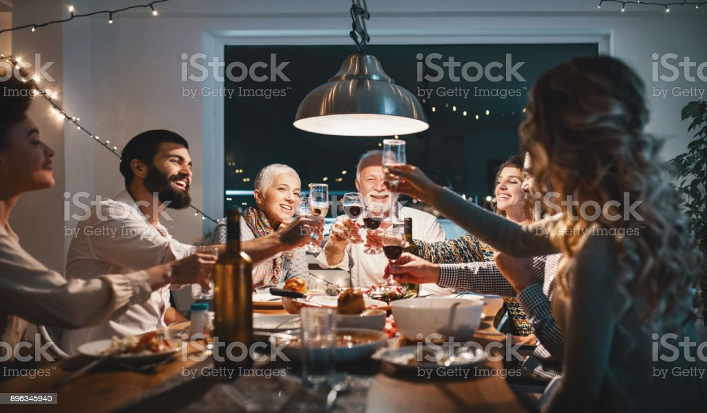 Family having dinner on Christmas eve. - Foto stock royalty-free di 60-69 anni