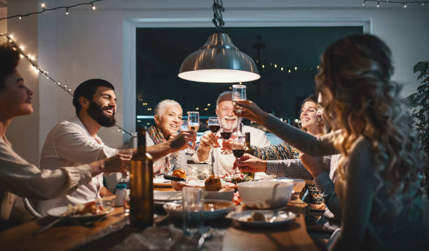 family having dinner on christmas eve. - family dinner stock photos and pictures