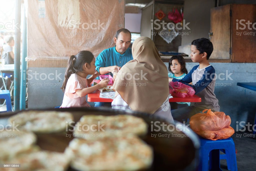 Family having food at restaurant after shopping - Royalty-free 10-11 Years Stock Photo