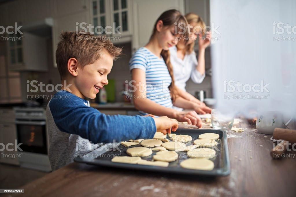 Family having fun baking cookies stock photo