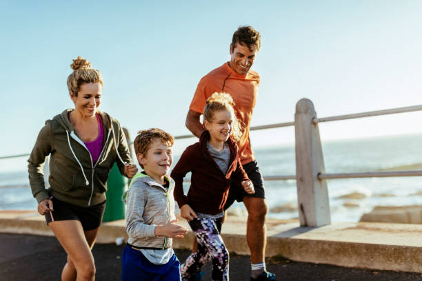 family having fun doing sports - vitality stock photos and pictures