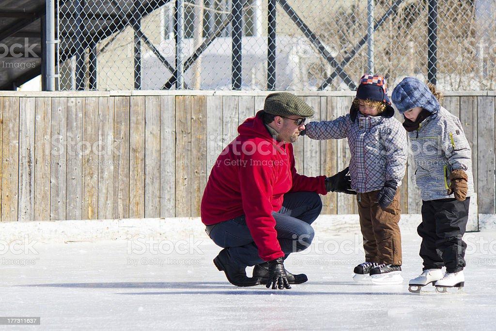 Family having fun ice skating stock photo