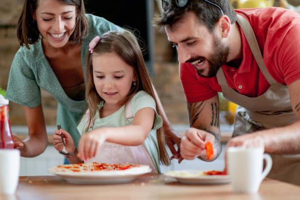 Family having fun in kitchen stock photo