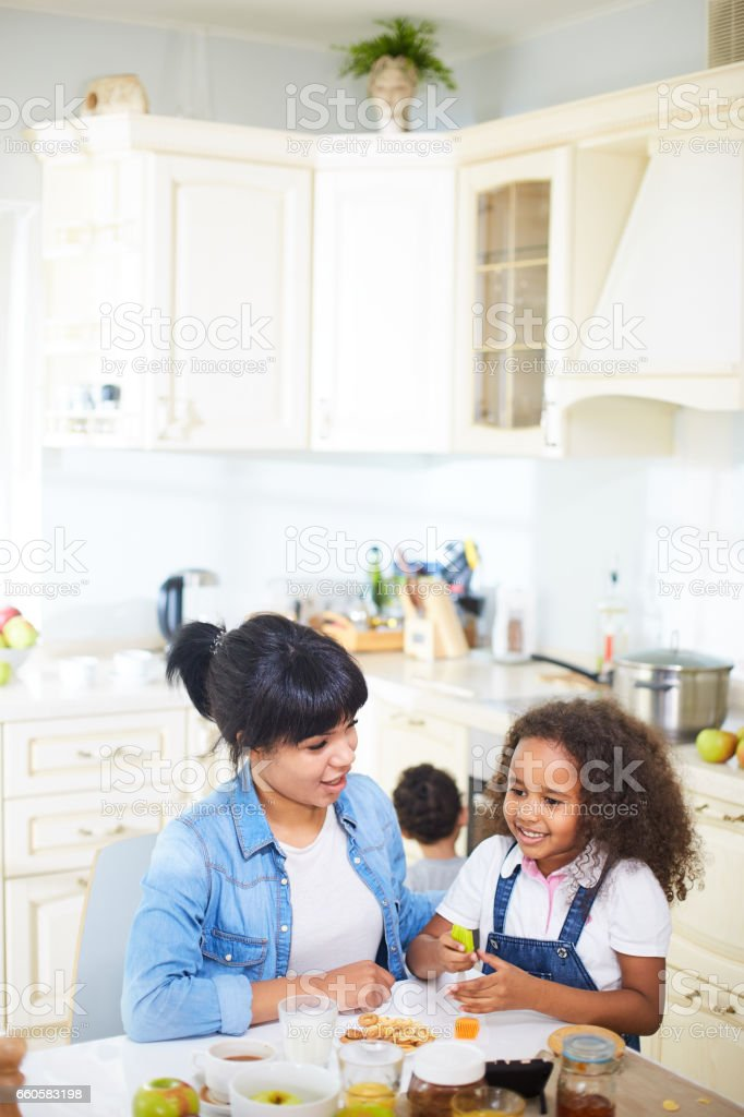 Family having fun in kitchen royalty-free stock photo