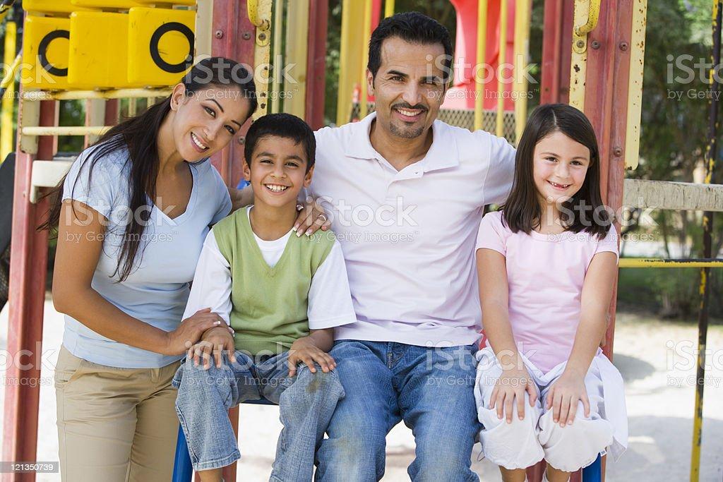 Family having fun in playground stock photo