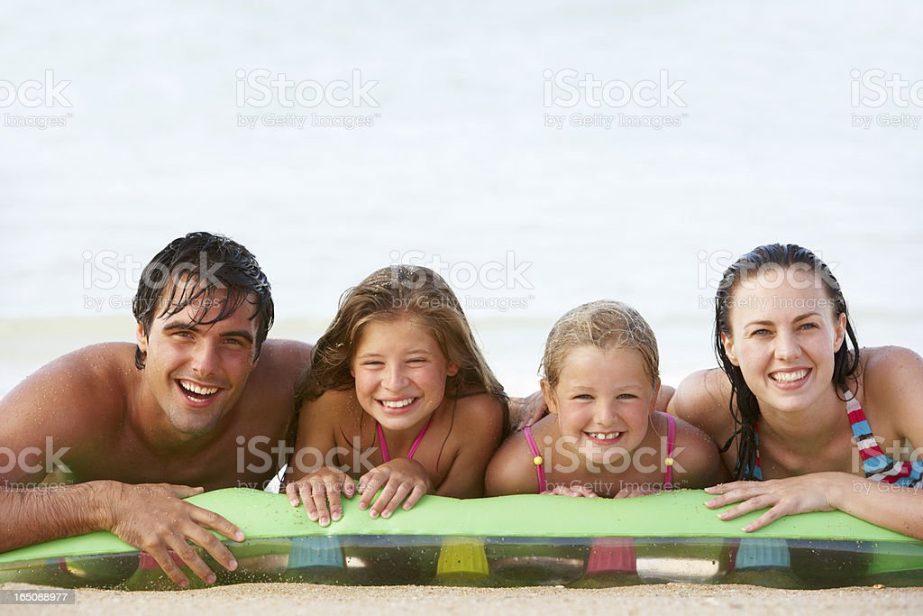Family Having Fun In Sea On Airbed royalty-free stock photo