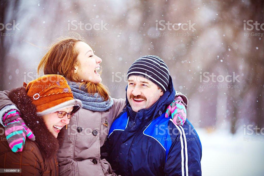 Family Having Fun in Snowy Woodland royalty-free stock photo