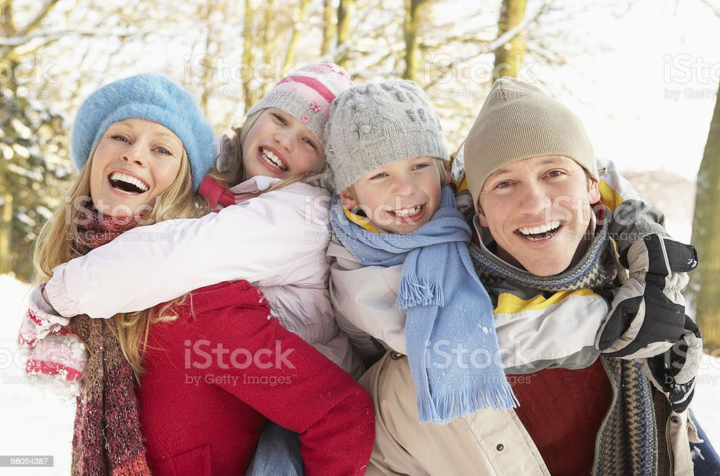 Family Having Fun  in Snowy Woodland stock photo