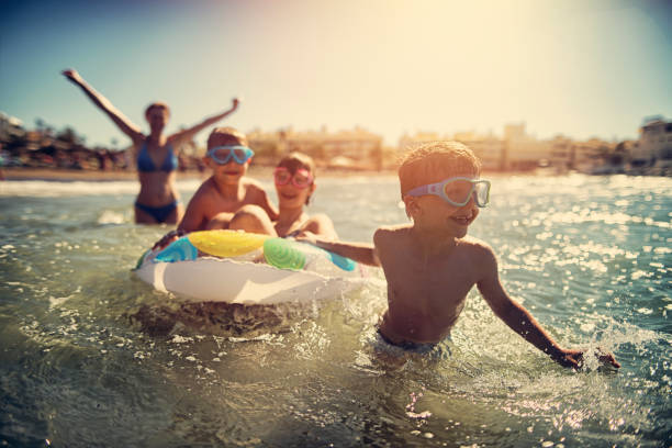 family having fun in summer sea - family vacation stock photos and pictures