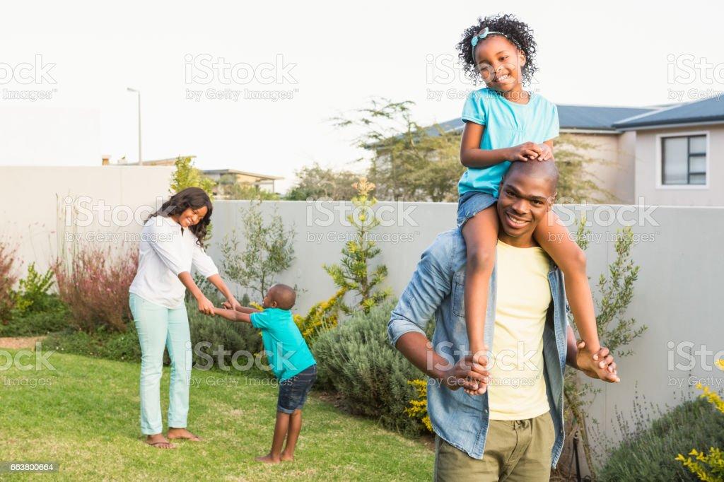 Family having fun in the garden stock photo
