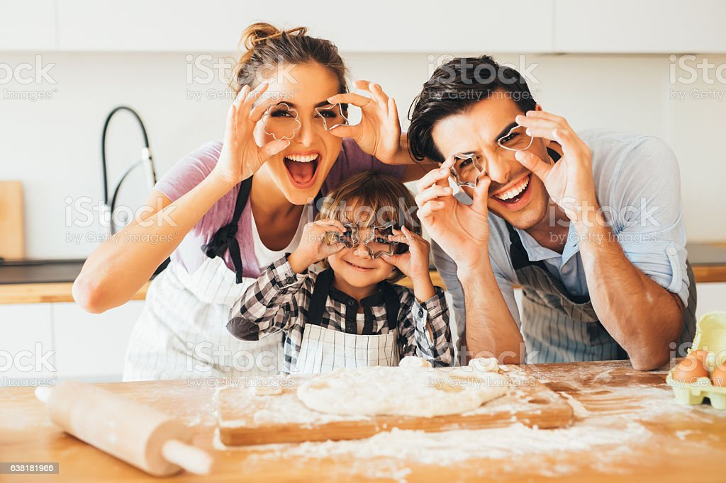 Family having fun in the kitchen stock photo